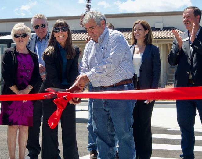 Redmond Mayor George Endicott breaks out the giant scissors. - CHRIS MILLER