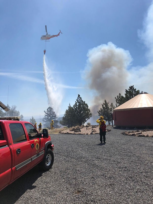 A helicopter drops water on the Graham fire near Lake Billy Chinook. - SUBMITTED