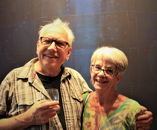 "Bill Hoppe and Sandy Anderson standing in front of ""West Went,"" created by Hoppe in 2015. - DANIELLE MEYERS"
