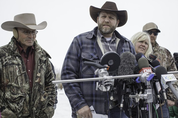 Ammon Bundy, center, speaks to reporters. - TIME.COM