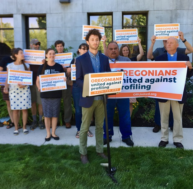 Noah Goldberg-Jaffe of the Oregon AFL-CIO speaks at the Deschutes County Courthouse on July 9. - CHRIS MILLER