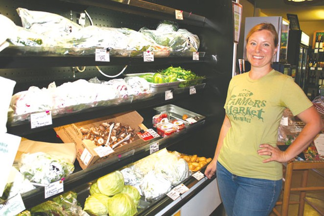 """Nicolle Timm Branch, founder of Central Oregon Locavore, shows off """"Bartholomew,"""" the current cooler that will be replaced with a mister. - NICOLE VULCAN"""