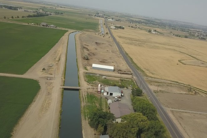 The North Unit Irrigation Canal parallels a farm in Madras. - TIM WEHDE, CENTRAL OREGON DAILY