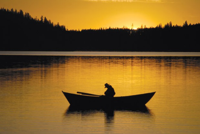 A lone fisherman at dusk on Paulina Lake. - FLICKR.COM/DIRTSAILOR2003