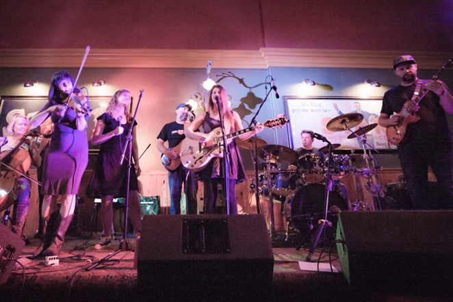 Lande performs originals by local singer/songwriter Jennifer Lande Sunday on the Music Makers Stage. - GARY CALLICOTT