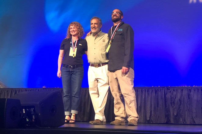 10 Barrel's Tonya Cornett and Ian Larkin accept their GABF awards from Brewers Association founder Charlie Papazian. - PHOTO BY KEVIN GIFFORD