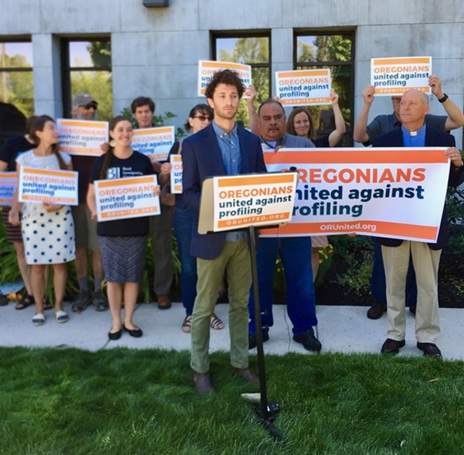DA John Hummel (not pictured) joined Noah Goldberg-Jaffe of the Oregon AFL-CIO, members of the clergy and members of the Latino Community Association in demonstrating against Measure 105 in front of the Deschutes County Courthouse July 9. - CHRIS MILLER
