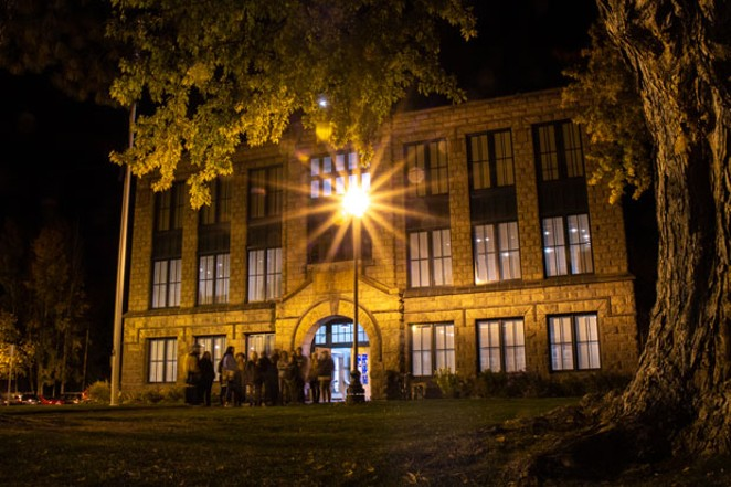 Tour-goers prepare for spooky stories in front of the Deschutes Historical Museum. - KEELY DAMARA