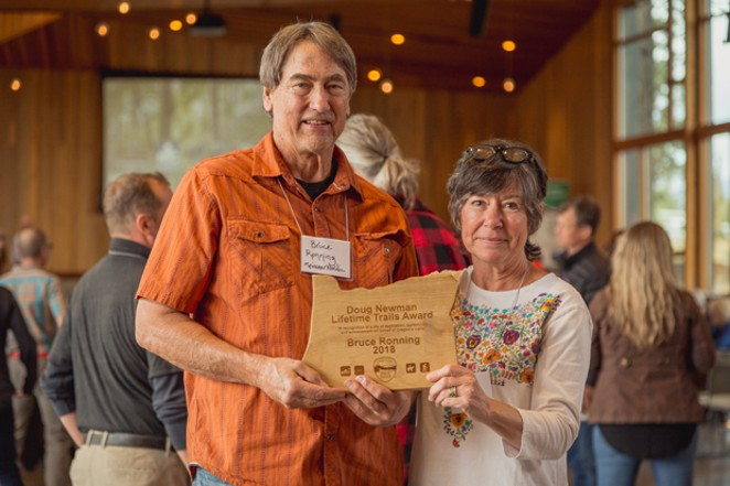 Bruce Ronning shows off his award at the Oregon Trail Summit. - GABRIEL AMADEUS TILLER