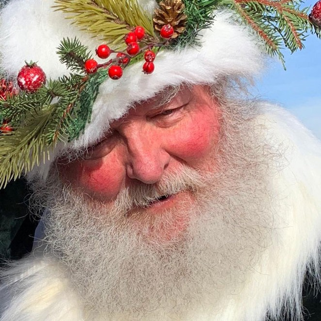 @joyfulrandom beams in this photo of ol' Saint Nick. Ho Ho Ho! Tag @sourceweekly to show up in Lightmeter. - SUBMITTED