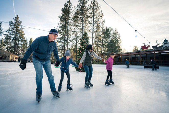 A family skates at the outdoor rink at the Seventh Mountain Resort last winter. - NATE WYETH