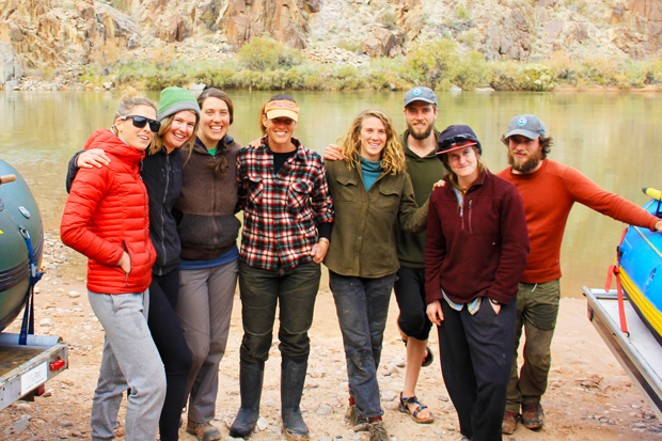 "The ""farmily"" at the Colorado River Dimond Creek takeout. L-R: Author K.M. Collins, Carly Maher, Aliza Rosenstei, Sarahlee Lawrence, Cailyn Brierley, Kyle McKnelly, Bridget Dahmer and Steven McKnelly. - K.M. COLLINS"