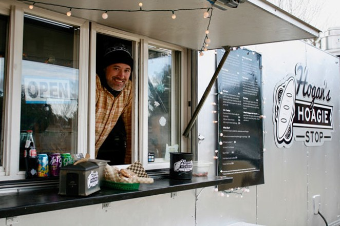 Co-owner Jason Hogan sticks his head out of the food cart. - CHRIS MILLER