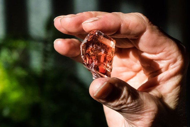 The author gets a closeup look at sunstone embedded in a piece of lava. - SUBMITTED