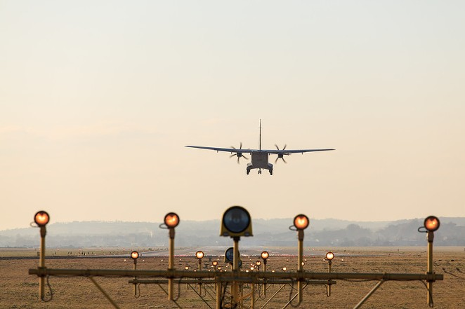 A plane lands using the airport's navigational system. - CANSTOCKPHOTO.COM