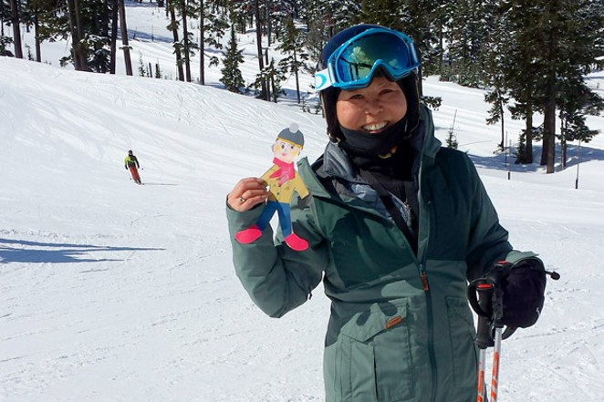 Mt. Bachelor rentals manager Sung Choi poses at the bottom of Pine Martin with The Cone as a backdrop. - SUBMITTED