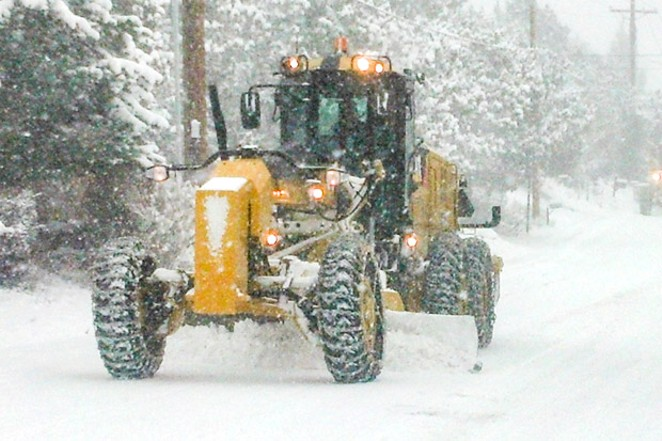 A contracted road grader plows a residential street in Bend. - THE CITY OF BEND