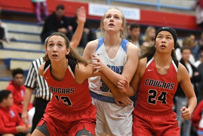 Bailey Dickerson, at left, boxes out for a rebound. - SUBMITTED