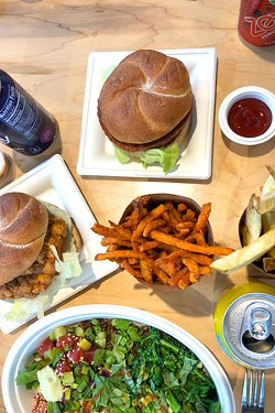 The Life and Time menu includes a crispy chicken sandwich, a Beyond Meat burger, sweet potato fries and a selection of bowls. - LISA SIPE
