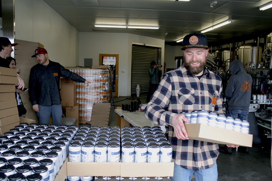 Riverbend's head brewer, Chasen Schultz loading a case of Blunder Armour at the brewery. - ISAAC BIEHL
