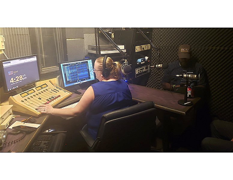 Katy Ipock, former KURT 93.7 host, interviews guest Johnny Alfredo for a recent KPOV broadcast. - CAYLA CLARK