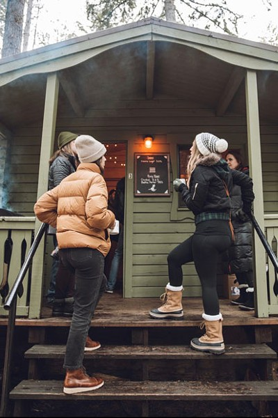 Beer festers bounced around between cabins, specialty brews and smoking grills. - CHEW & TASTE PHOTOGRAPHY