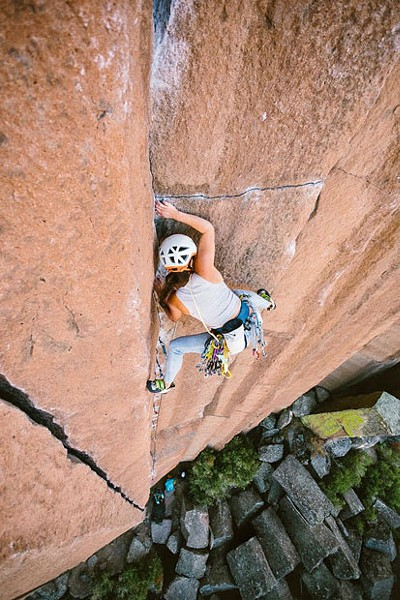 Rock climber Lizzy VanPatten scales the side of a cliff. - NICOLE WASKO