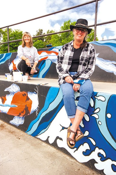 Artists Tracy Thille and Kris Cranston at the Redmond skate park mural. - DARRIS HURST