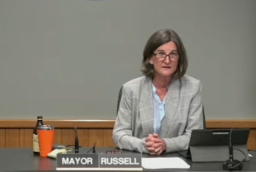 Mayor Sally Russell reads a prepared statement to respond to the critiques of her response to the ICE raid and protest. - SCREENSHOT VIA CITY OF BEND