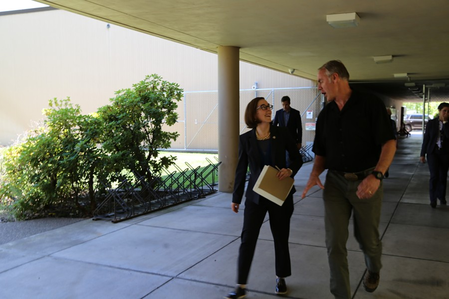 Gov. Kate Brown walks with Interior Secretary Ryan Zinke during a meeting discussing the Cascade-Siskiyou National Monument. - KATE BROWN/FLICKR