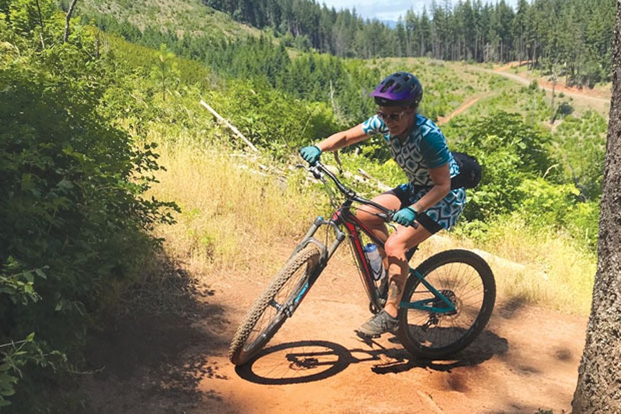 Emily Carr navigates a switchback in Post Canyon—in a cycling dress. - SEFANO SPEDINI