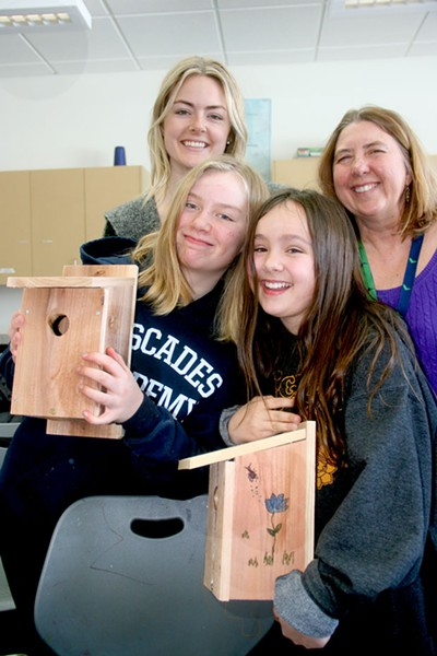Students Katie and Sophia show their nesting boxes. Behind them, from left, are Michelle van Hilten, program administrator for Think Wild, and Anne-Marie Eklund, science teacher at Cascades Academy. - JIM ANDERSON