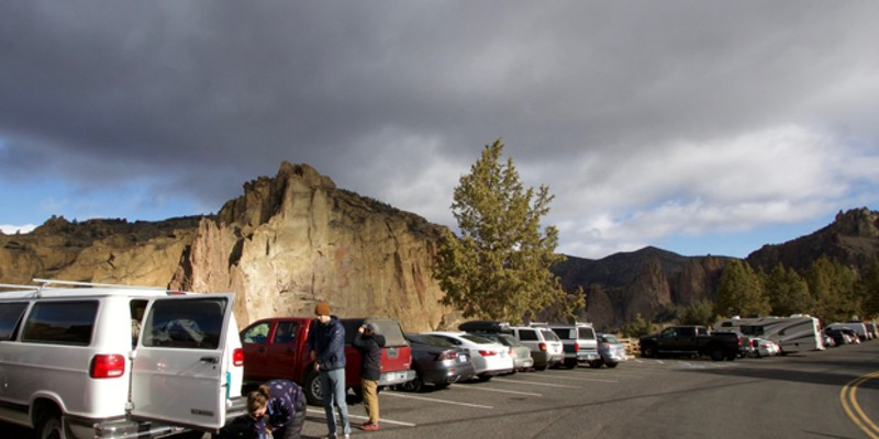 Emily Johnson, left, Darren Redden, center, and Tim Han, prepare for a day of climbing at Smith Rock State Park April 10. They arrived early to snag a parking spot on the weekend. Local law enforcement has been cracking down on cars parked illegally along the nearby roads, carrying fines of up to $115.
