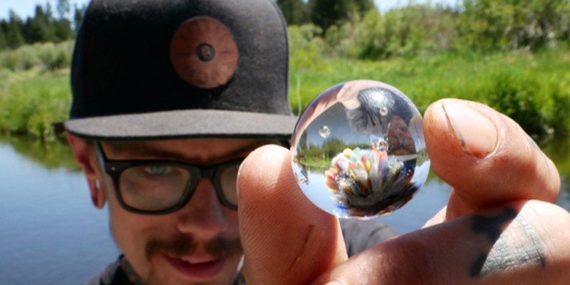 Chris Davis holds one of his teeny, tiny pieces of art.
