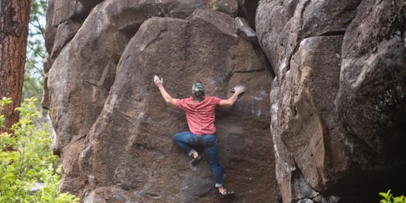 Author Jason Chinchen, of a locals' fan-favorite climbing book, climbs at Widgi Boulders.