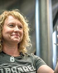 Brewmaster Tonya Cornett of 10 Barrel inspects one of her latest endeavors.