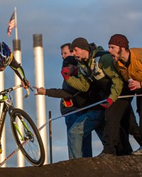 Tim Johnson jams during a 2012 cyclocross race in Bend and gets heckled by spectators.