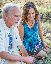 Bill Kuhn and Paula Latasa-Kinzer inspect the love of Kuhn's life, the local mariposa lily.