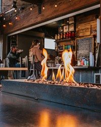 Gathering around the fire is an age-old custom that food cart lots embrace.
