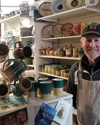 Studio member Mike Hoffman, maker of hand-thrown, functional stoneware, in his studio.