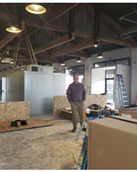 John Heylin stands in the space that is slowly being transformed into Unofficial Logging Co., Bend's first hatchet-throwing bar.