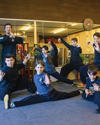 Master JianFeng Chen and Oregon Tai Chi Wushu students prepare for an upcoming IWUF competition.