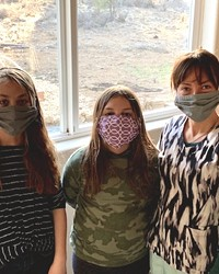 """The author's two daughters and wife, wearing the """"new normal"""" garb."""