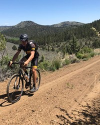 Kevin English tops the hill on the Bonanza Route.