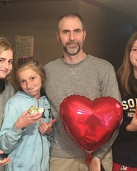 PJ Bartz with her sisters and dad, celebrating the one-year anniversary of her heart transplant.