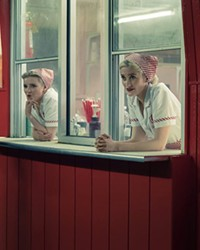 You do not want to stop here for a milkshake. Trust the look on her face.