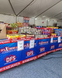 Jake Dennis, who volunteers at Discount Firework Superstore, said business slowed down some after the firework ban went into effect, but also said the customers still buying were buying more.