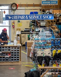 Nico Brilmyer works the repair station at Gear Fix in Bend.