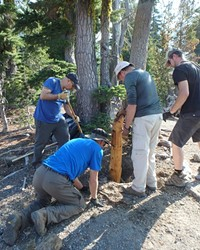 Friends of the Central Cascades replacing trail junction signs.