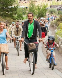 Amanda Stuermer, World Muse Director, and Michael Franti lead the pack on a past Soulrocker bike ride. Photo by Jill Rosell.